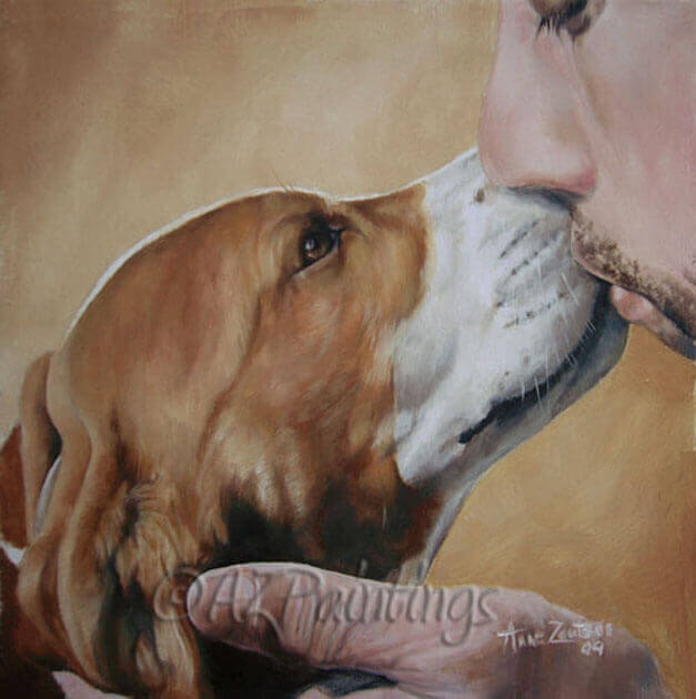 A beagle and owner kiss