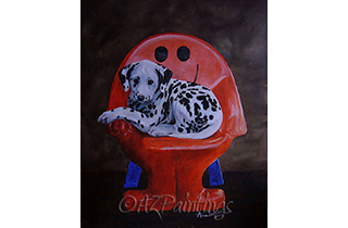 A Dalmatian puppy lying on a Mr Smiley chair